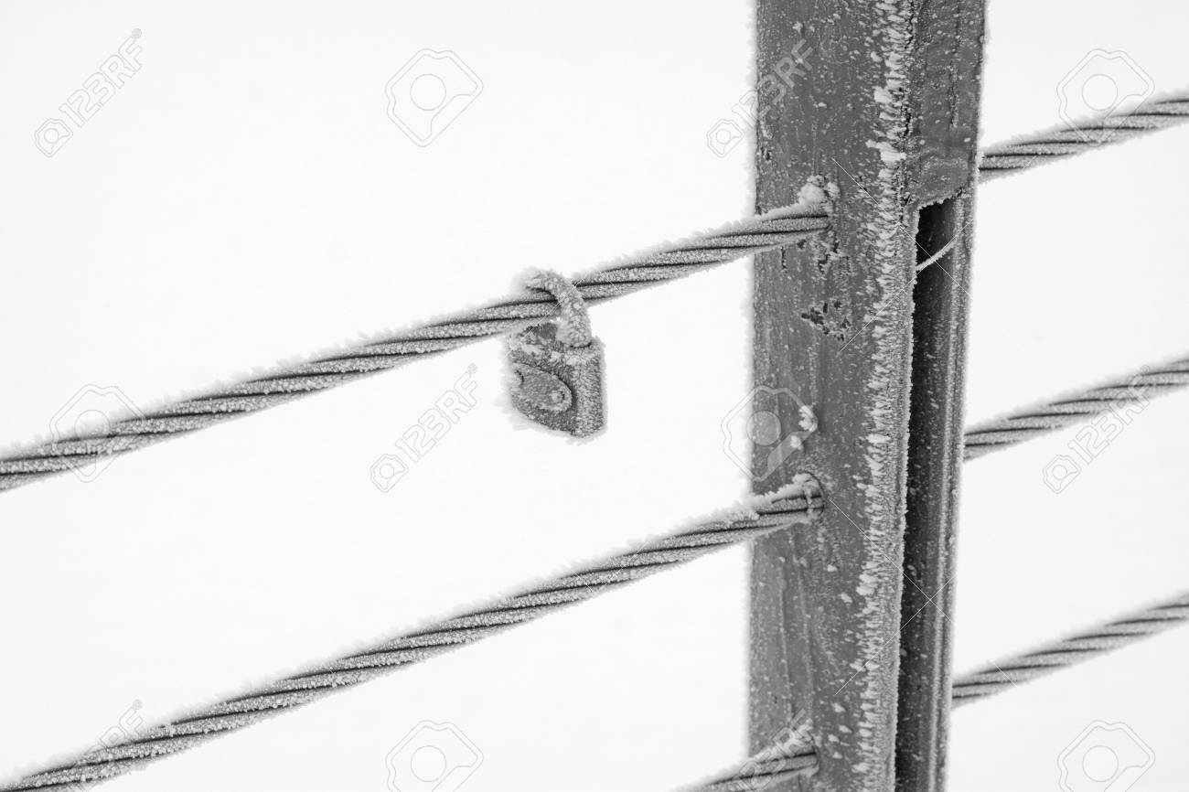 Wire Rope Pillar And Locks In The Frost And Snow Stock Photo ...