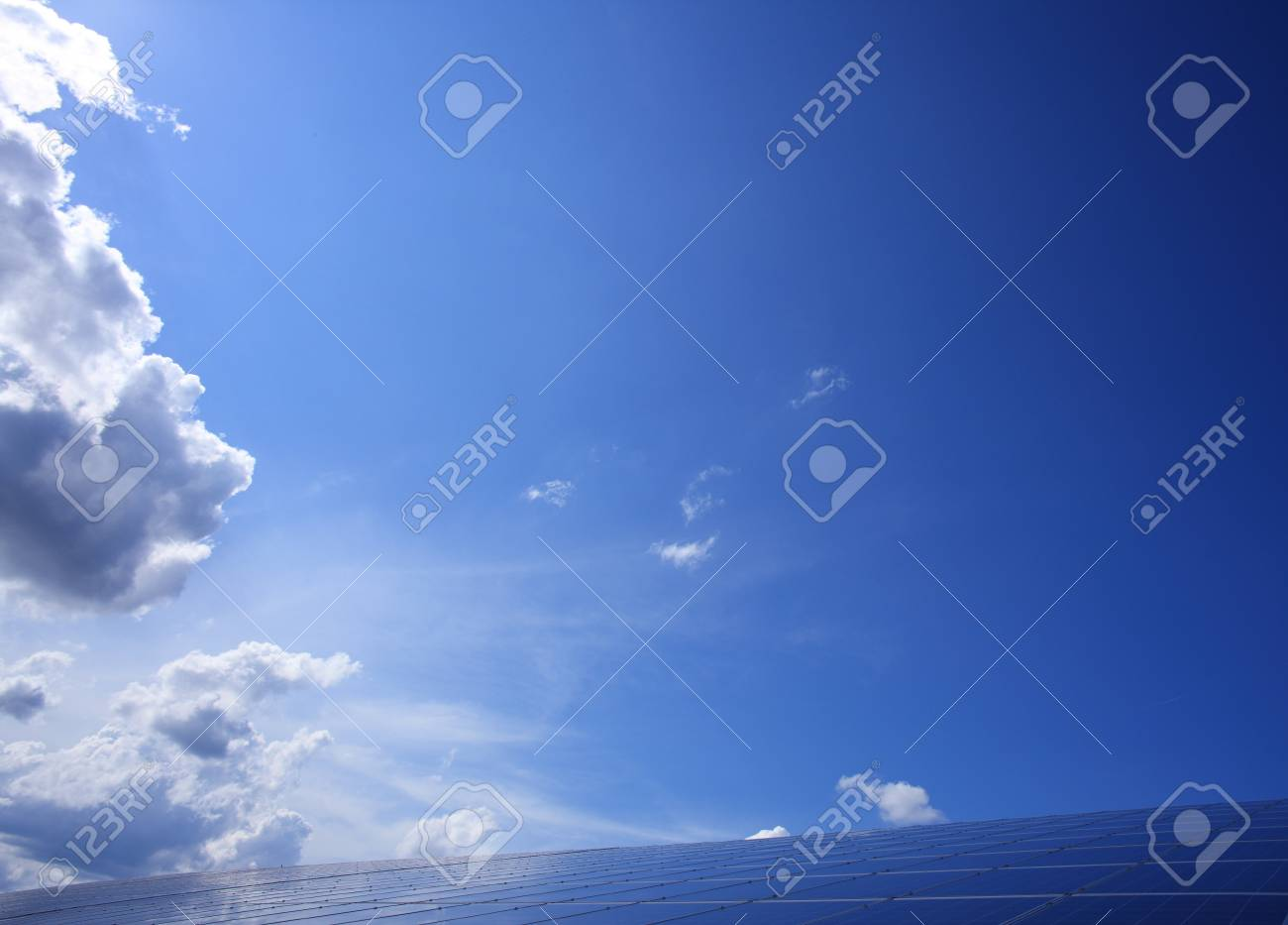 Blue sky and ocean background with some clouds. Stock Photo - 14273336