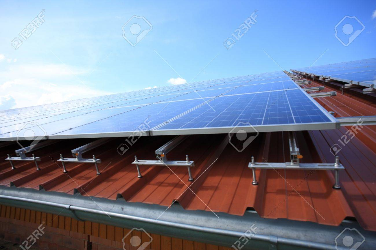 Solar panels placed on roof against blue sky Stock Photo - 14272643