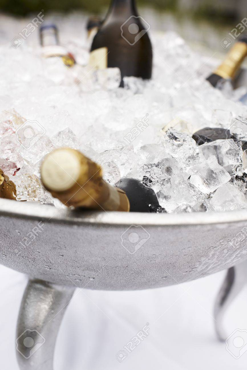 Multiple bottles of unopened champagne cooling in a large metal container of ice at a wedding or catered function Stock Photo - 14529998