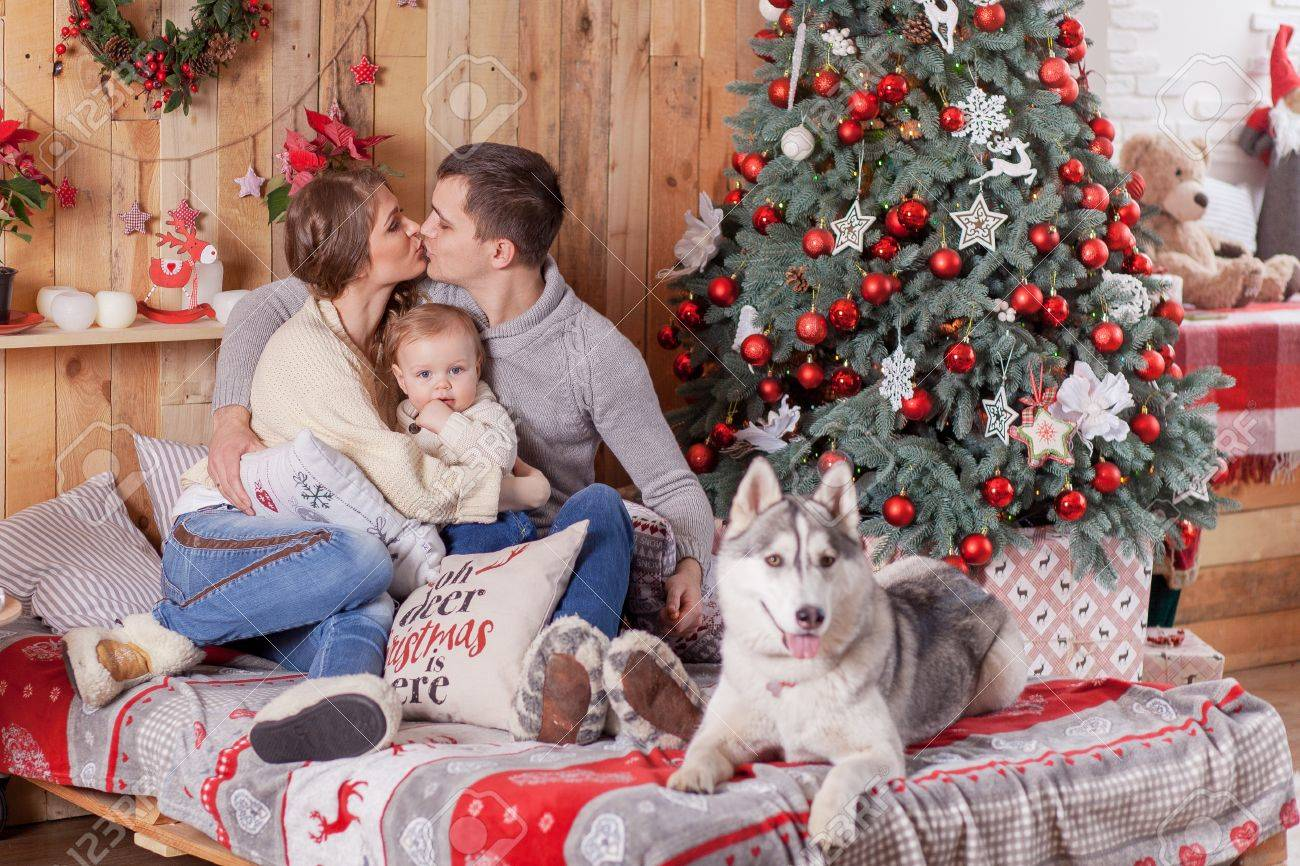 Family Around Christmas Tree Part - 47: Happy Family And A Dog Siberian Husky Near The Fireplace Around The Christmas  Tree Stock Photo