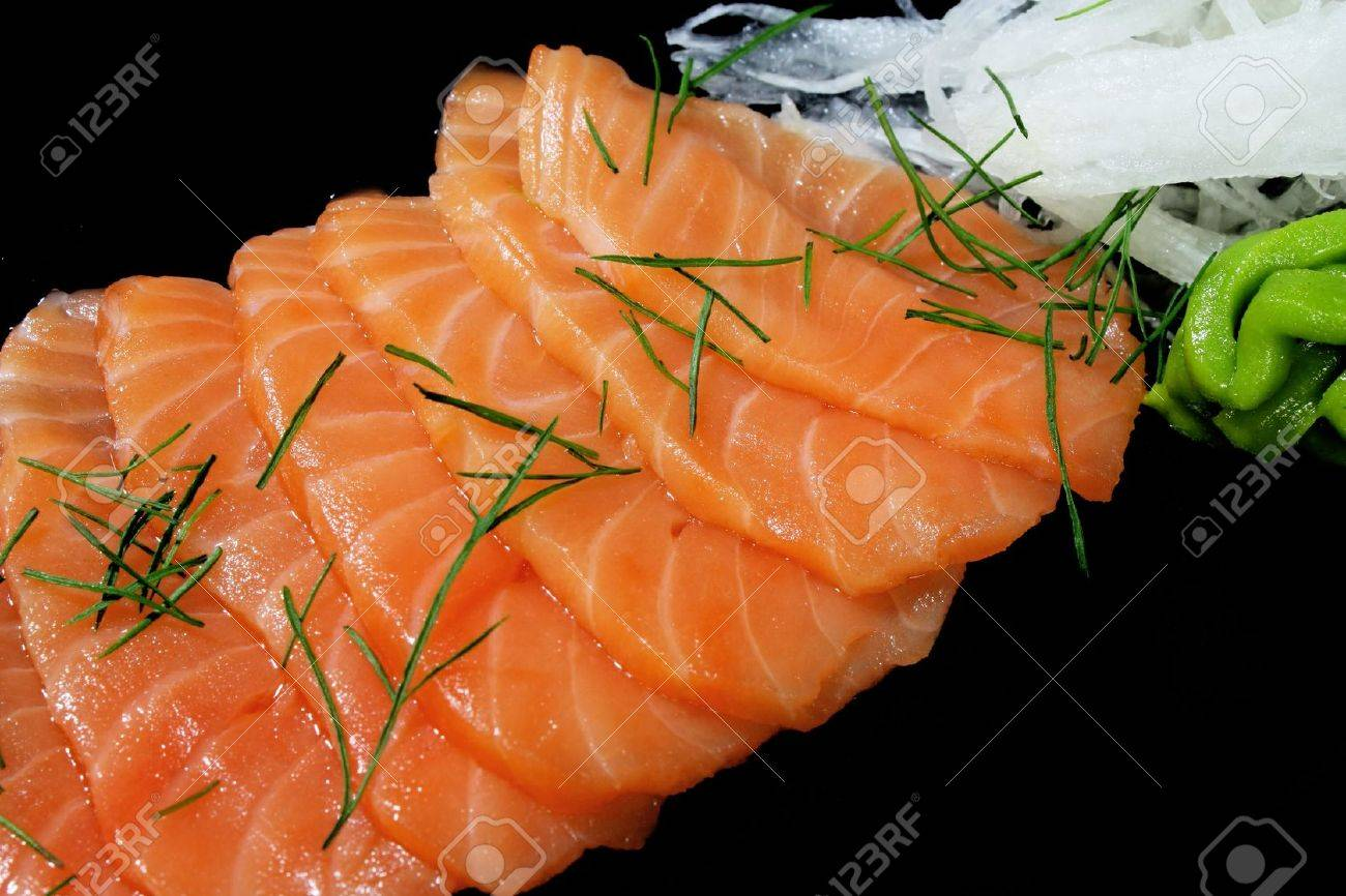 Close-up image of smoked salmon on black background Stock Photo - 9543380