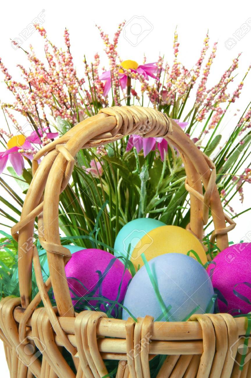 Easter colored eggs in the basket on the white background Stock Photo - 11990033