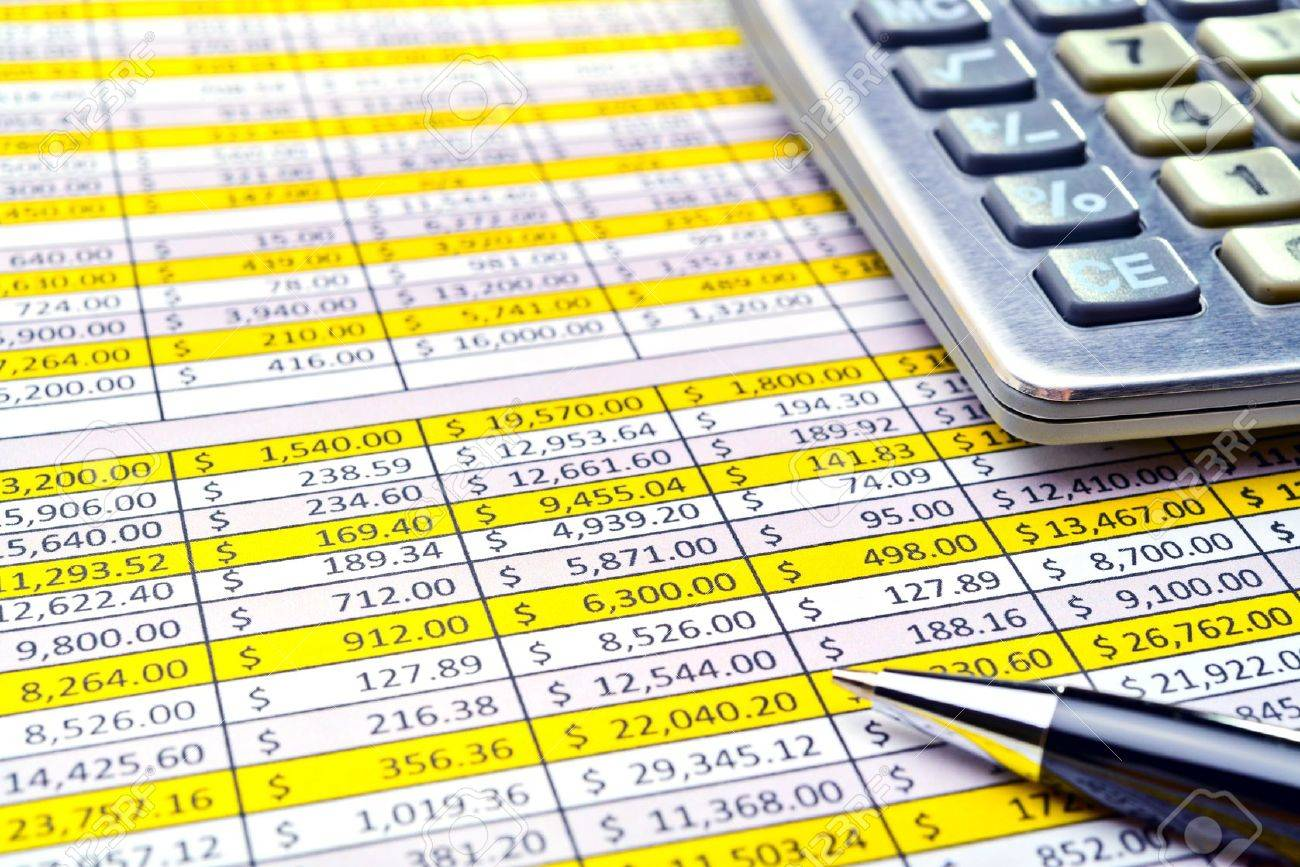 Financial forms with pen and calculator. Stock Photo - 16944939