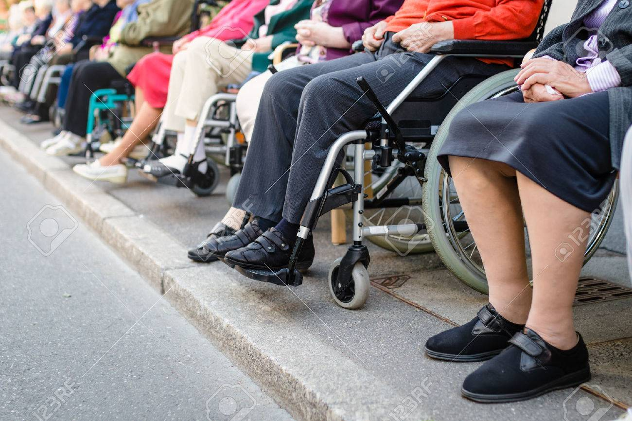 Row Of Old People In Wheel Chairs. Selective Focus Stock Photo ...