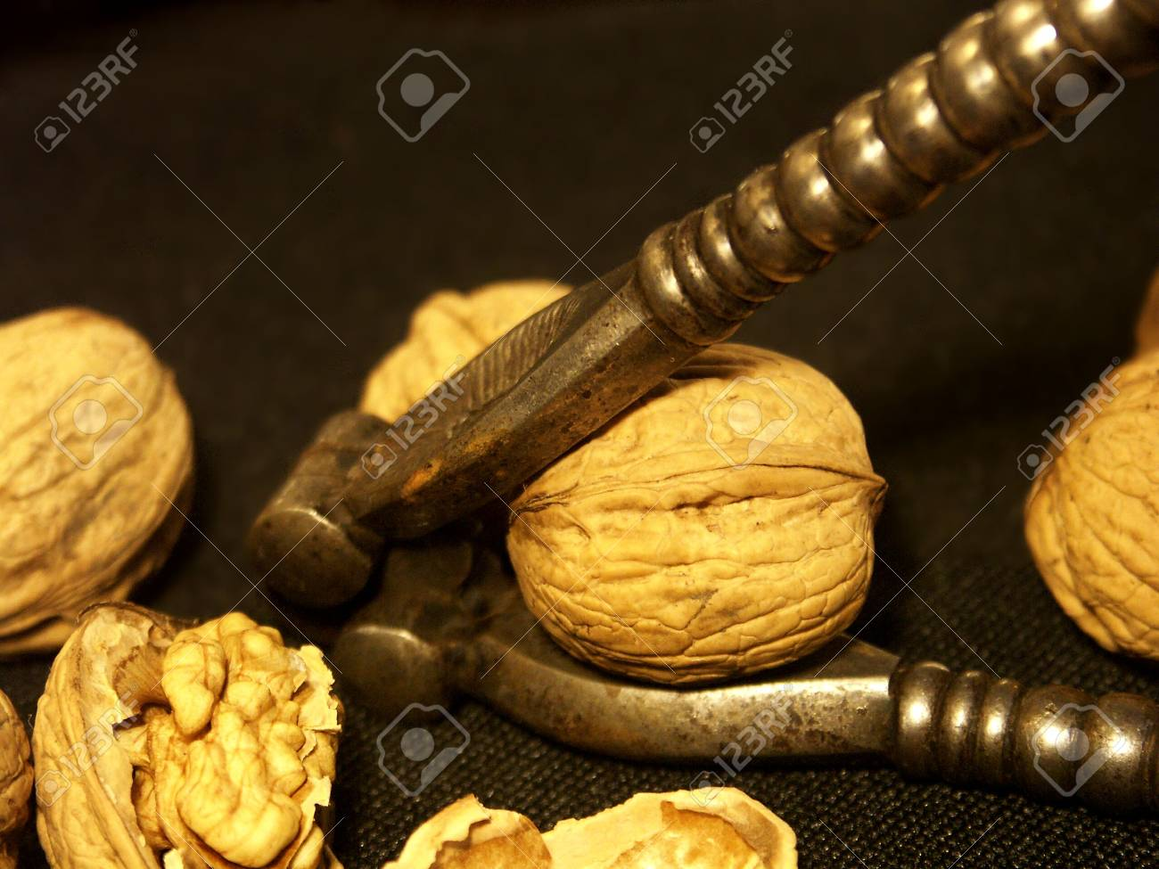Bronze-walnut isolated onblack background Stock Photo - 974104