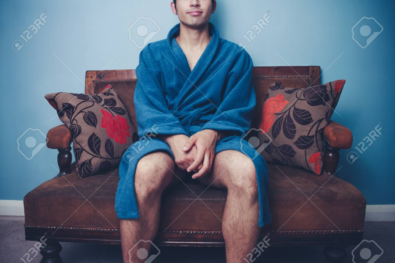 Young Man In Dressing Gown Is Relaxing On Old Vintage Sofa Stock Photo Picture And Royalty Free Image Image 22085925