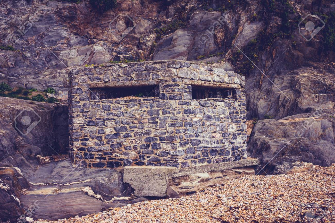 Old world war two bunker on the beach Stock Photo - 23527185