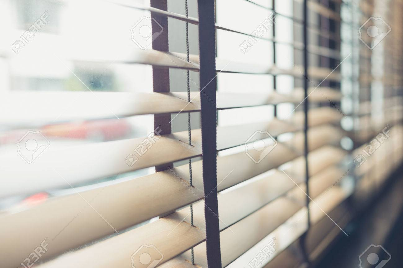 Stock Photo Sunlight Coming Through Venetian Blinds By The Window