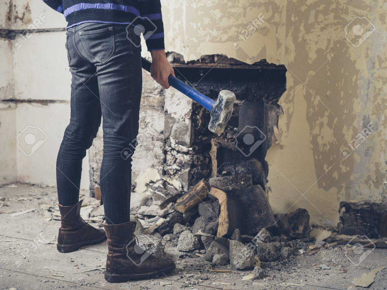 a young woman is opening up an old fireplace in a victorian house