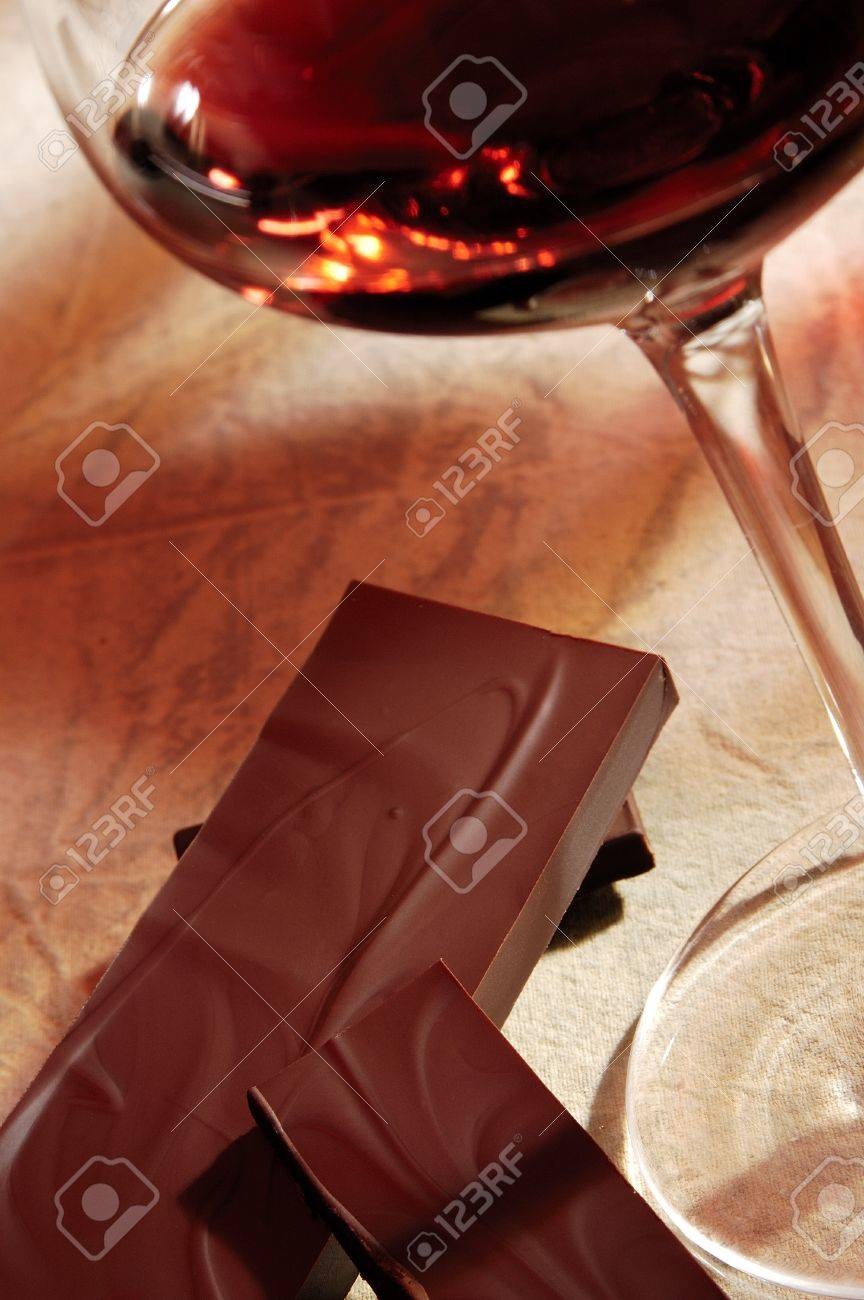glass of red wine with chocolate Stock Photo - 8287877