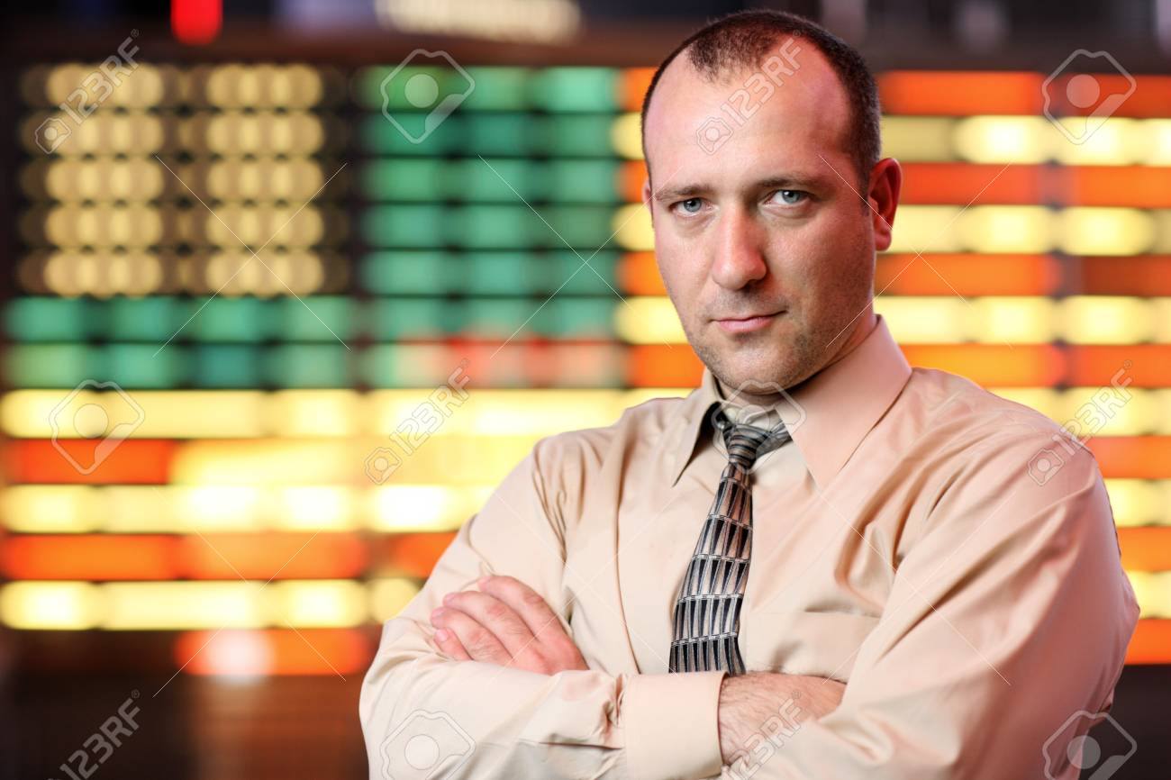 Businessman over stock exchange background Stock Photo - 4319996