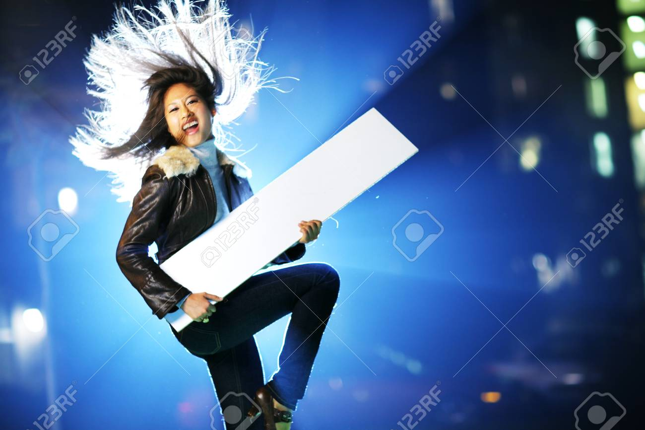 Young woman pretending to play on white board Stock Photo - 4320276