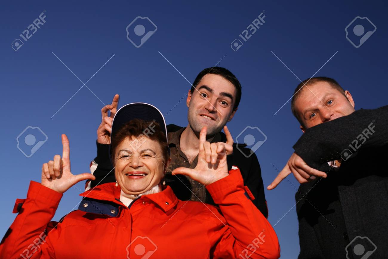 Grandmother and grandsons having fun outdoors Stock Photo - 4320104