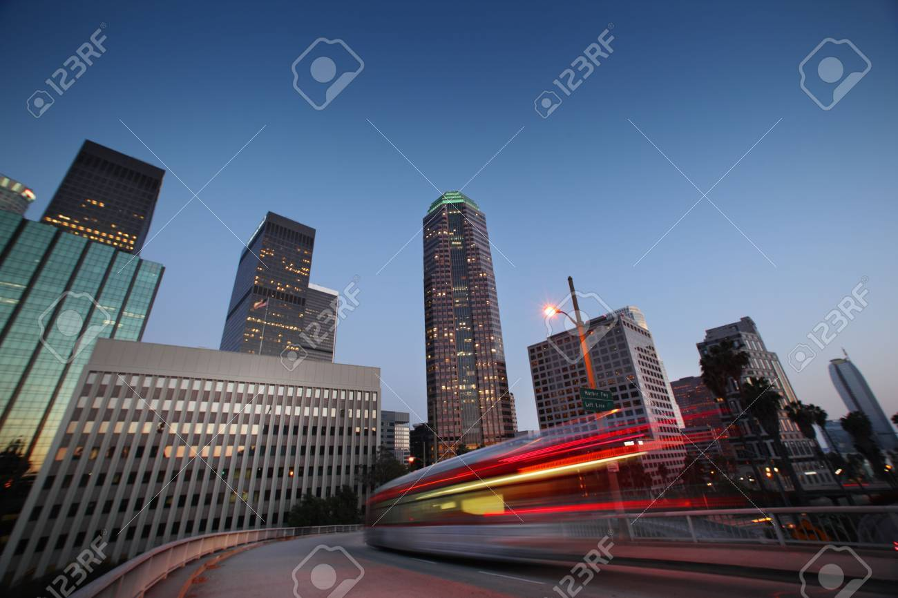 Bus speeding in downtown Los Angeles at twilight. Stock Photo - 5424453