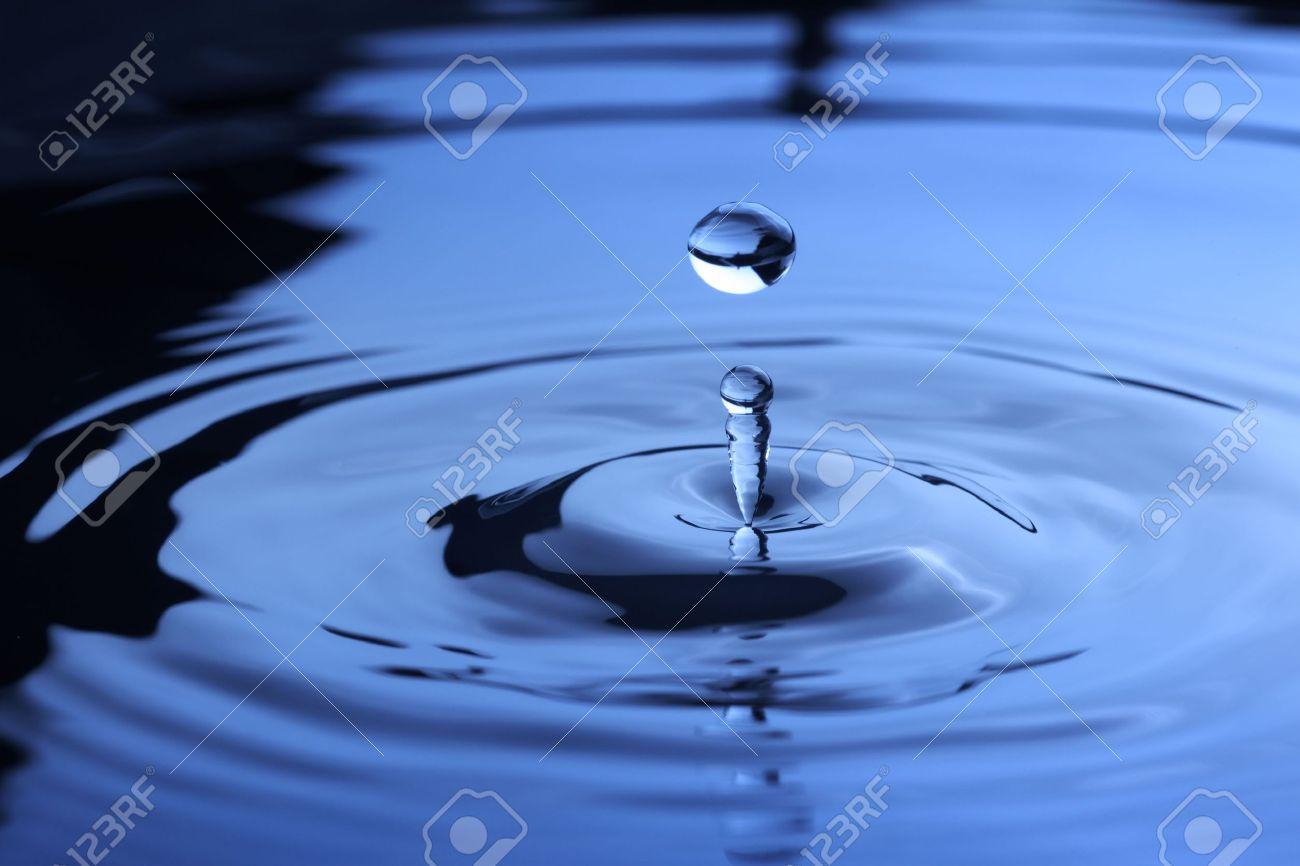 Water drop falling into water Stock Photo - 5948417