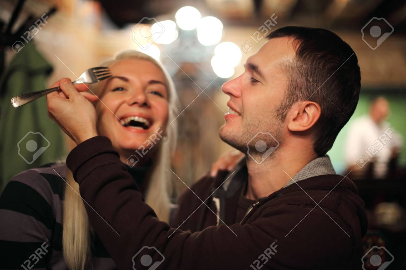 Young couple having fun in restaurant Stock Photo - 5971520