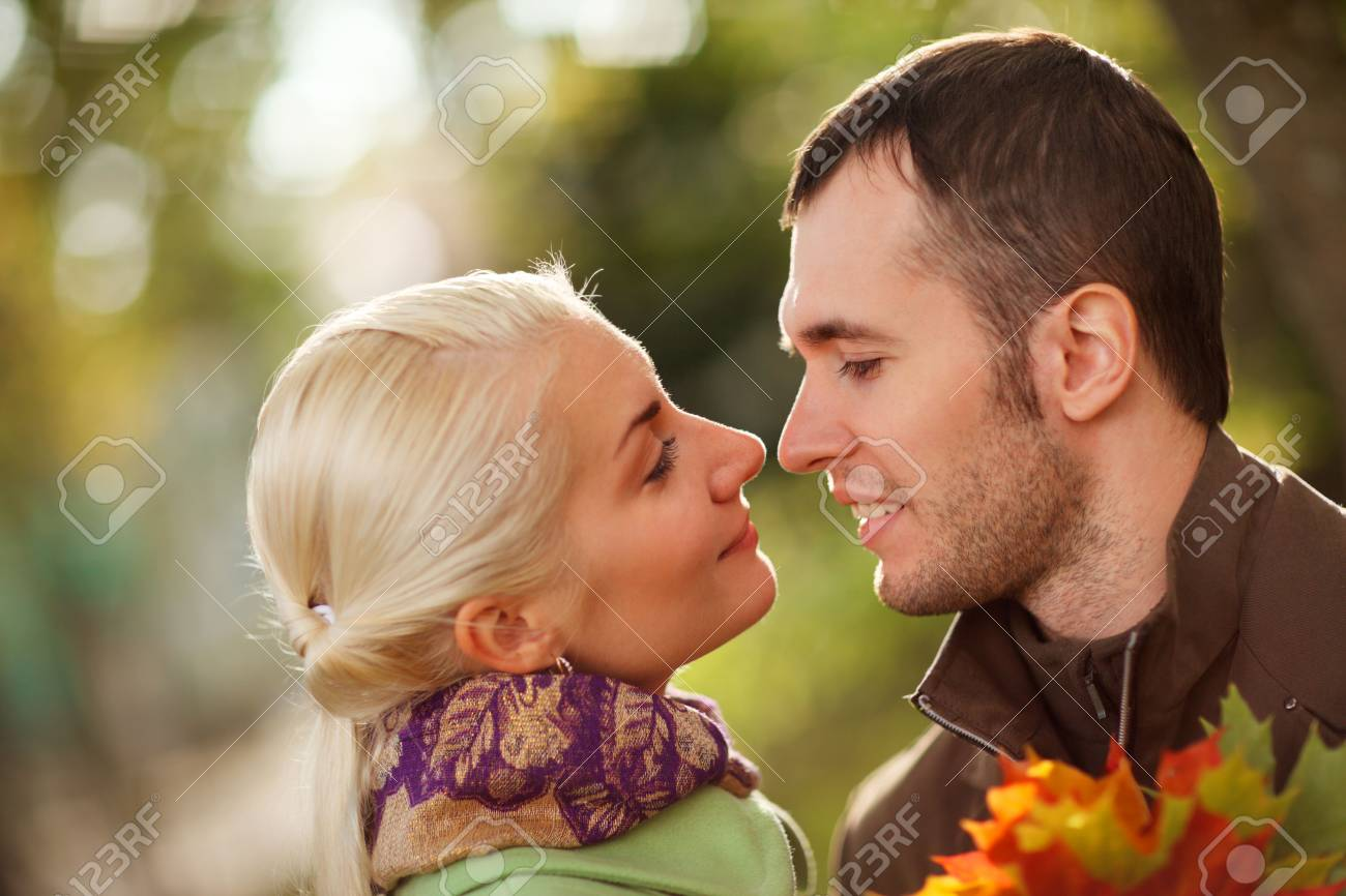 Young couple in love outdoors in park, close-up, shallow DOF. Stock Photo - 5971525