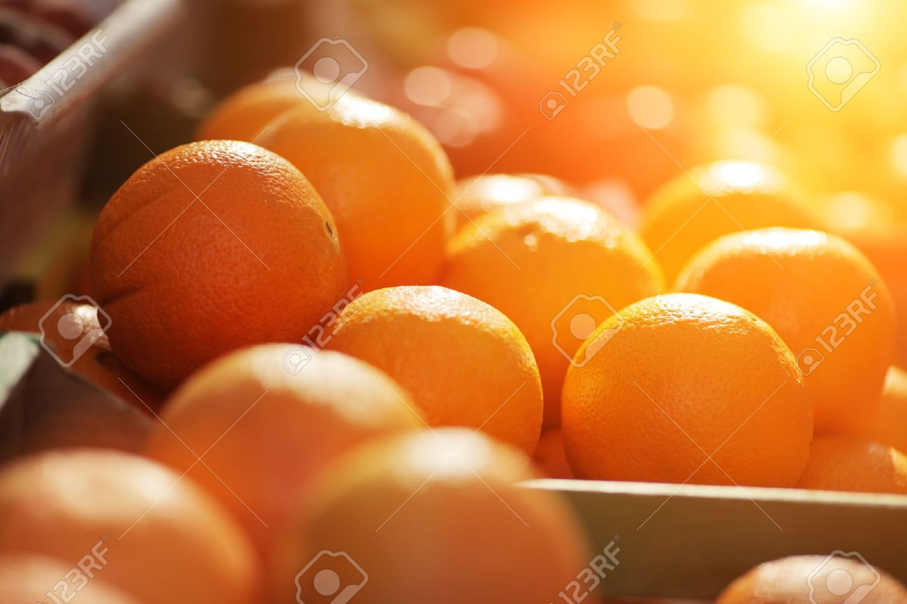 Fresh organic oranges on display on sunny day. Shallow DOF. - 8393422