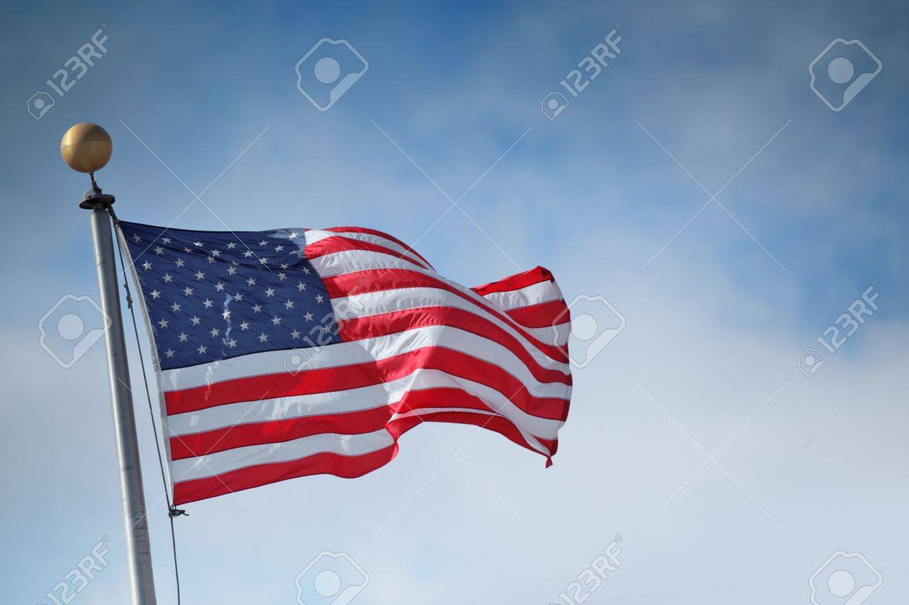 Flag of the United States of America over blue sky background Stock Photo - 10776585