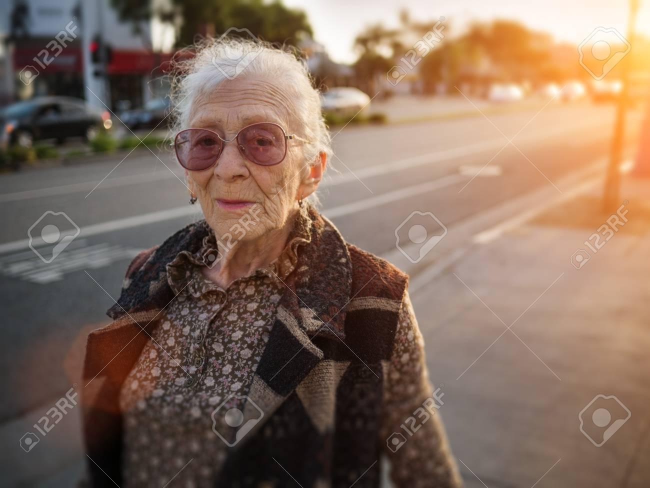 Portrait of senior woman on city street, closeup. Stock Photo - 24276221
