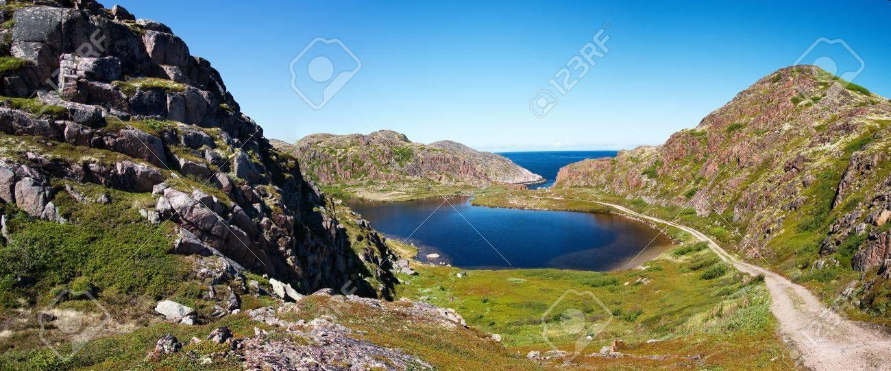 Blue lake in great mountain. Kola Peninsula. Summer. Barents Sea Stock Photo - 7519557