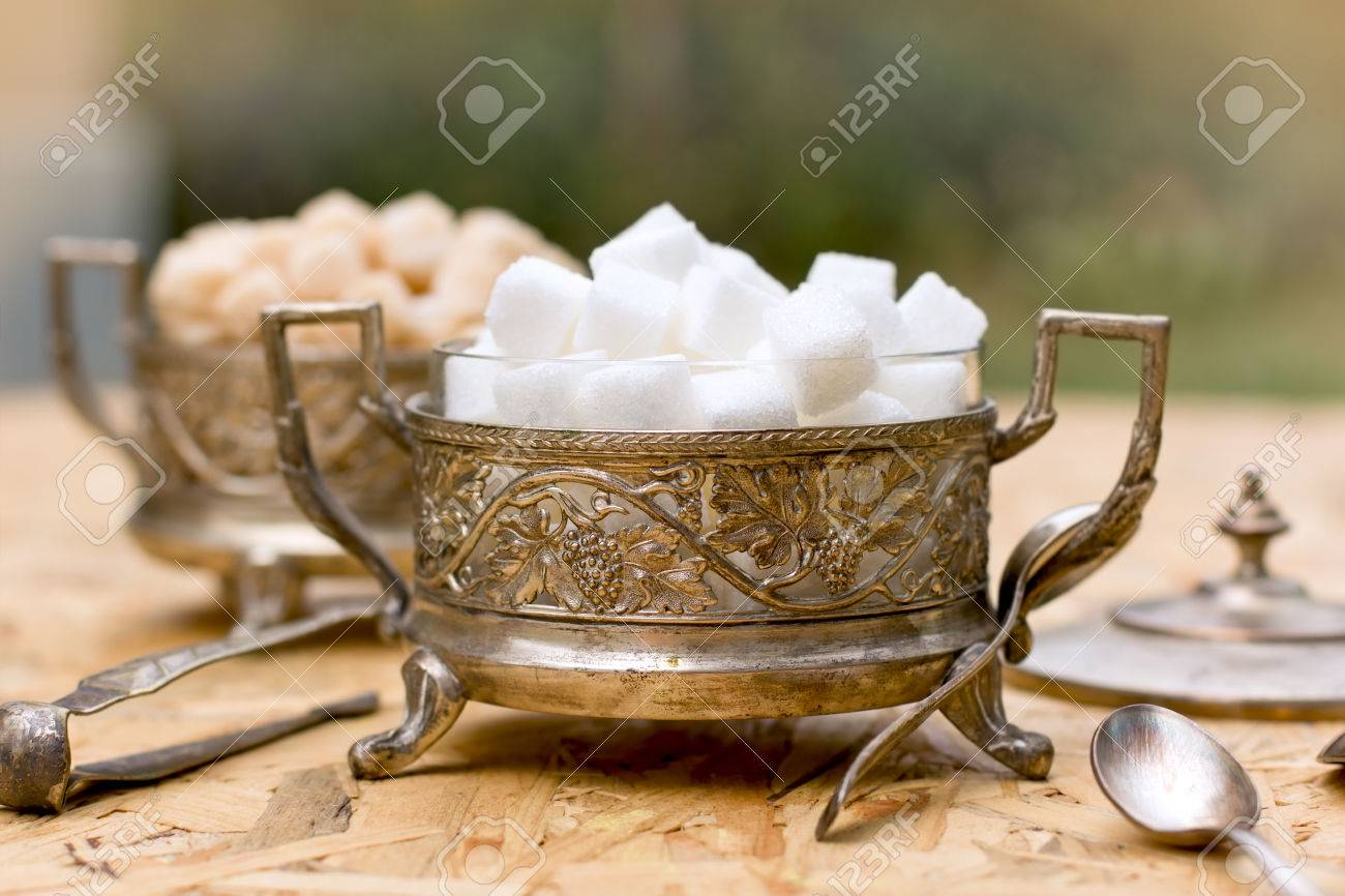 Yellow sugar bowls with lids - Stock Photo White And Yellow Sugar Cubes In Silver Containers Antique Bowls