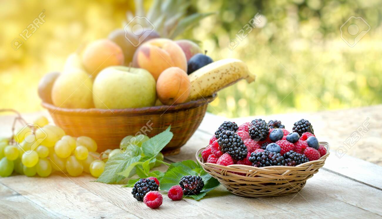 Forest fruit, forest berries in basket on wooden table - 141631781