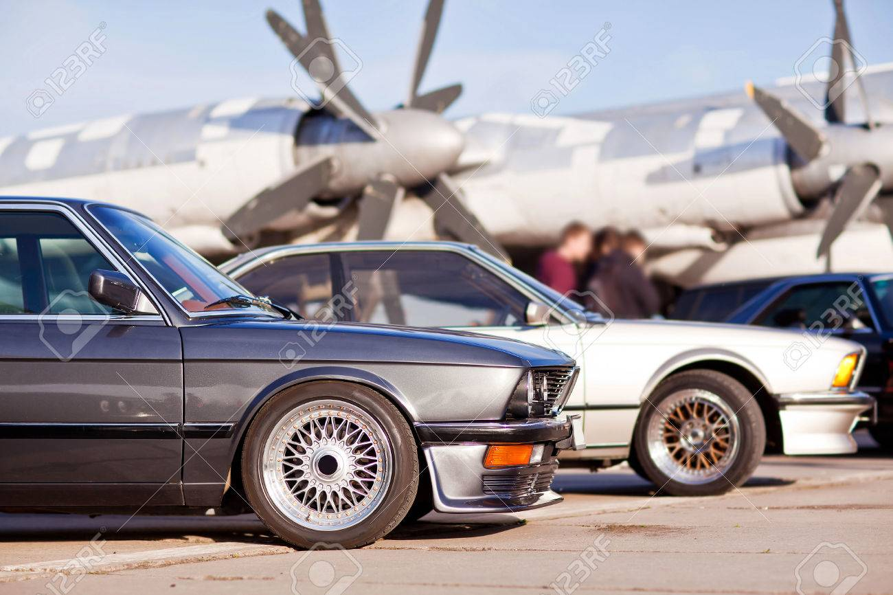 Right Front Side Of Two Old European Sport Cars With Plane On ...