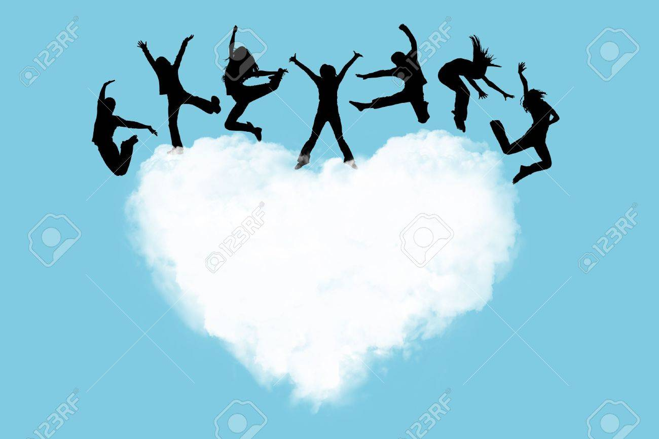 Silhouettes of the people jumping on a heart in the sky Stock Photo - 5782973