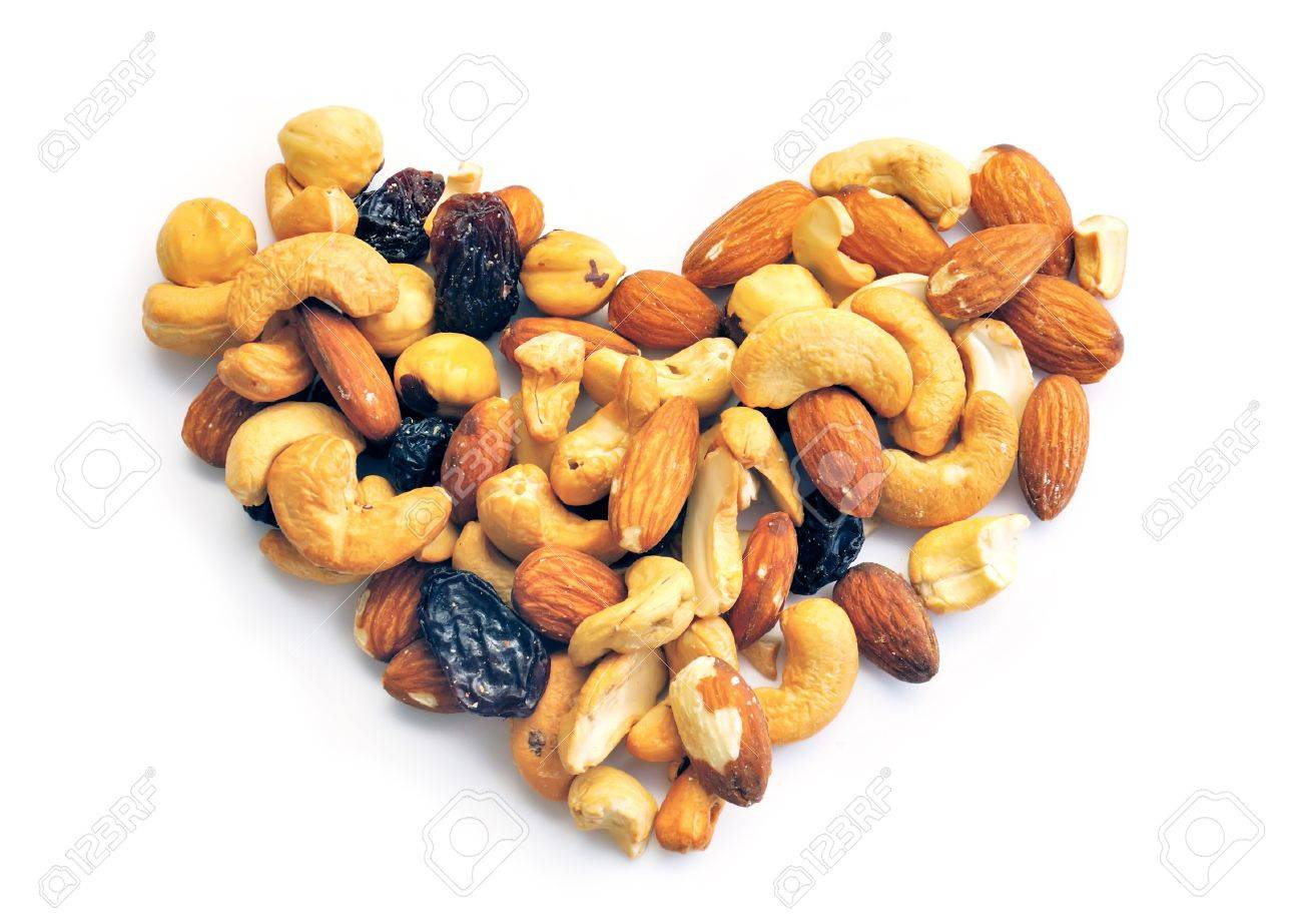 Heart from dried fruits (nuts) is isolated on a white background Stock Photo - 11658423