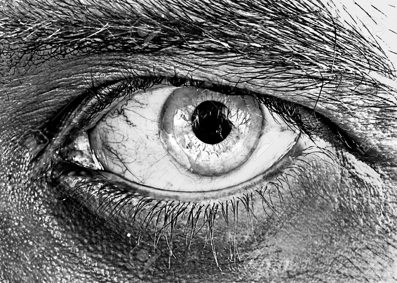 Close up of human eye in black and white with sharp focus and clarity and