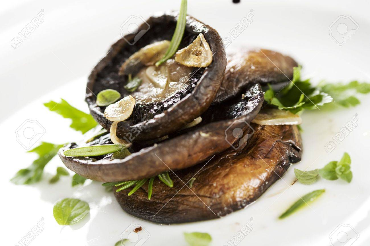 grilled portobello mushrooms, covered in herbs and garlic Stock Photo - 7769301