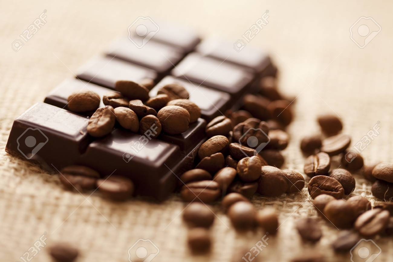 close up of dark chocolate with coffee beans around, shallow dof Stock Photo - 8955466