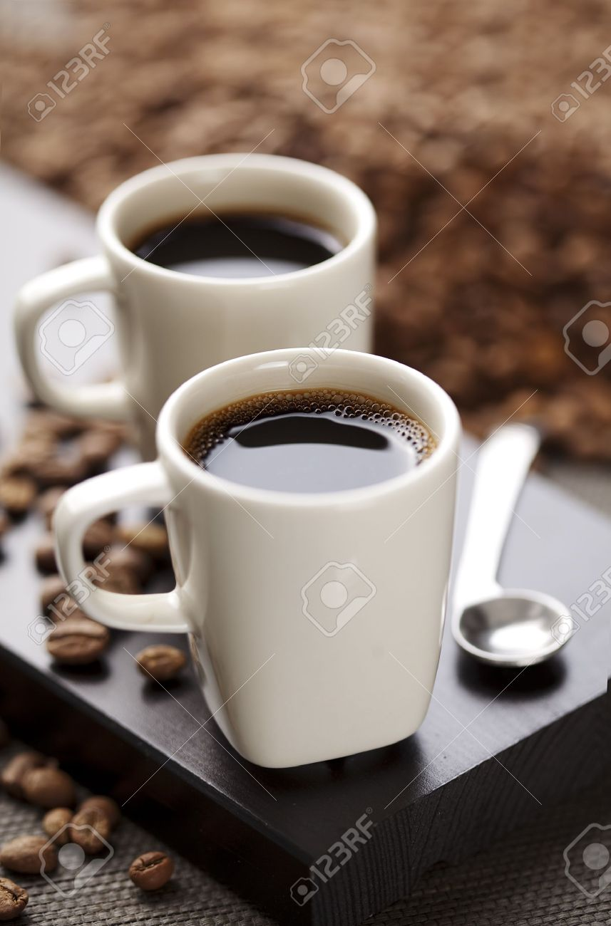 two modern espresso cups on a wooden table stock photo picture  - two modern espresso cups on a wooden table stock photo