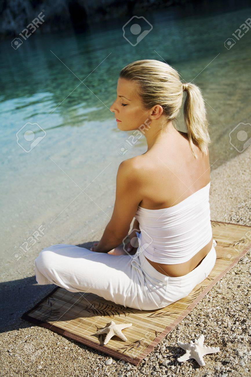serene woman doing  yoga on a beautiful beach Stock Photo - 10714715