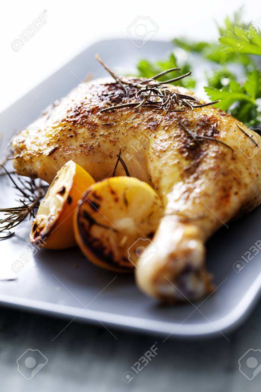 closeup of roast chicken and oven potatoes - 12614430