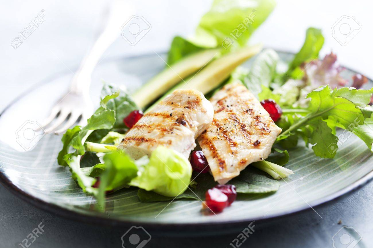 closeup of a healthy chicken salad with greens and pomme granate seeds and avocado Stock Photo - 12614691