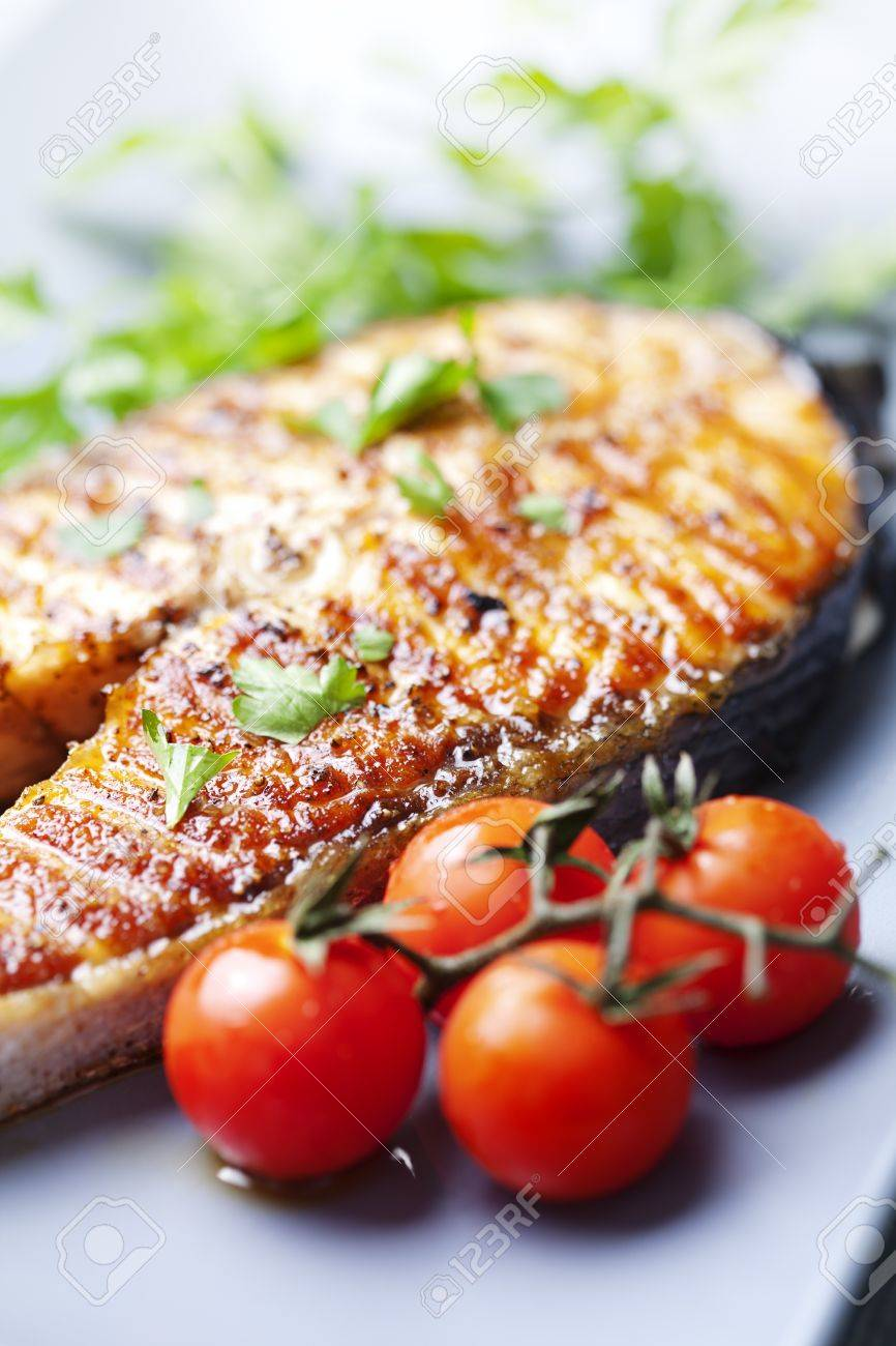 crispy grilled salmon steak with cherry tomatoes and parsley Stock Photo - 12614576