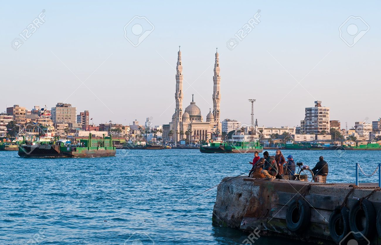 The ferries crossing suez canal in port saidegypt stock photo stock photo the ferries crossing suez canal in port saidegypt publicscrutiny Gallery