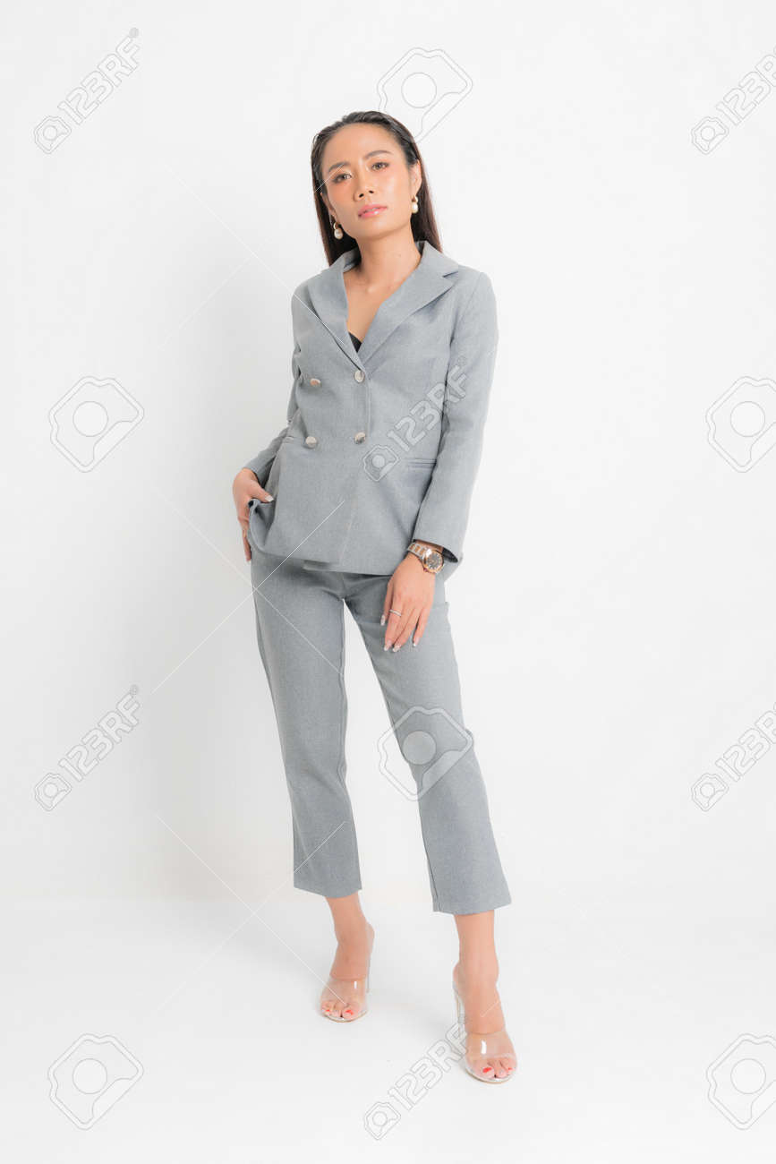 Fashion style catalog clothing for business woman black long hair natural make up wear gray suit costume perfect body shape suit at studio shoot on white background and shadow. - 170177674