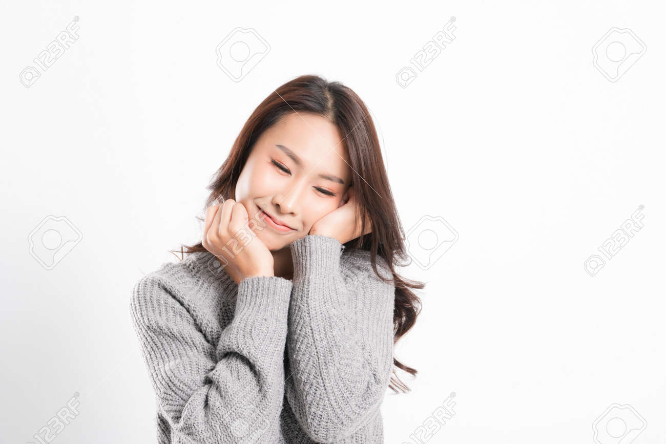 Pretty smiling joyfully being happy asian woman portrait with perfect skin and wearing a gray sweater in profile at studio shot isolated on white background. - 170208063