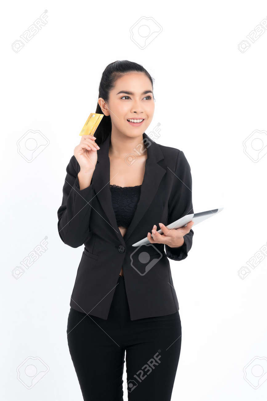Portrait asian business woman with holding credit card and tablet in hand isolated on white background. Concept business and online marketing. - 170208083