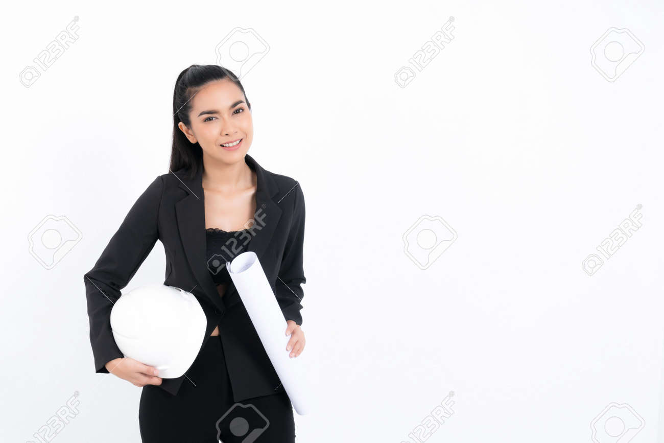 Portrait young engineer woman wearing black suit holding blueprint and white safety-helmet in shot studio isolated on white background. - 170208087