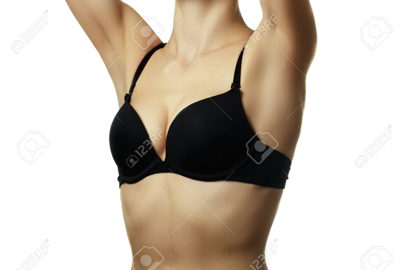 Closeup of a woman wearing a black bra isolated on white background.  Beautiful and sexy c6c5a214c