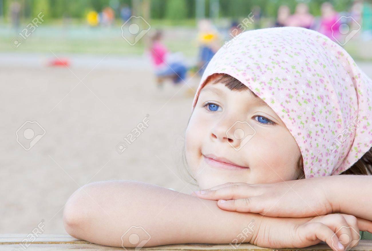 small girl playing on children's playground Stock Photo - 10550692