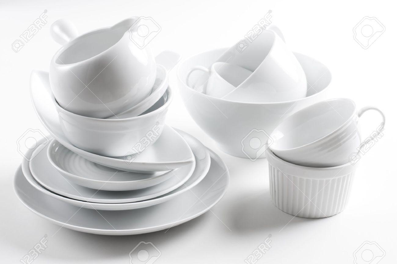 White Kitchen Utensils a lot of white crockery and kitchen utensils on white background