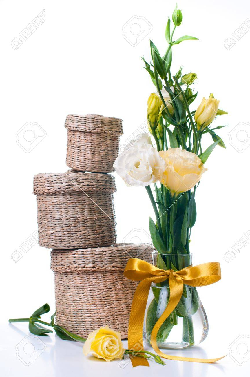 Three wicker boxes and a bunch of yellow flowers on a white background Stock Photo - 12949249