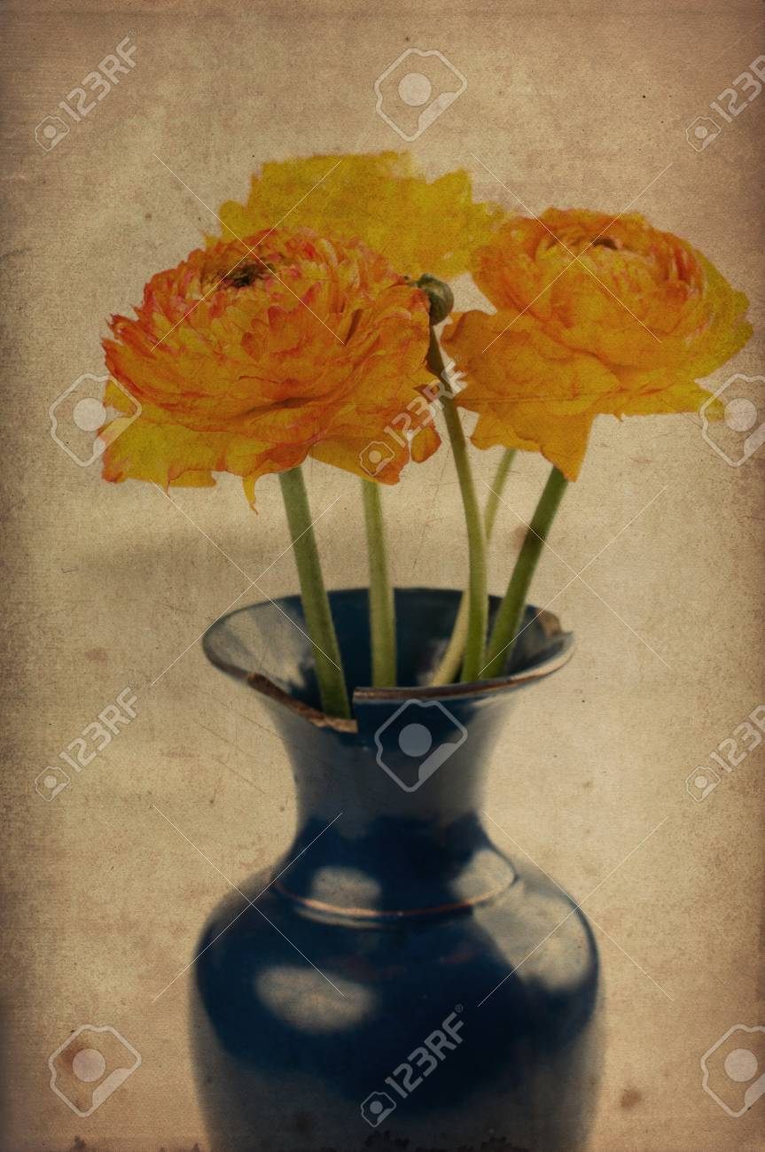 Vintage background with yellow-orange flowers in a vase Stock Photo - 13153634