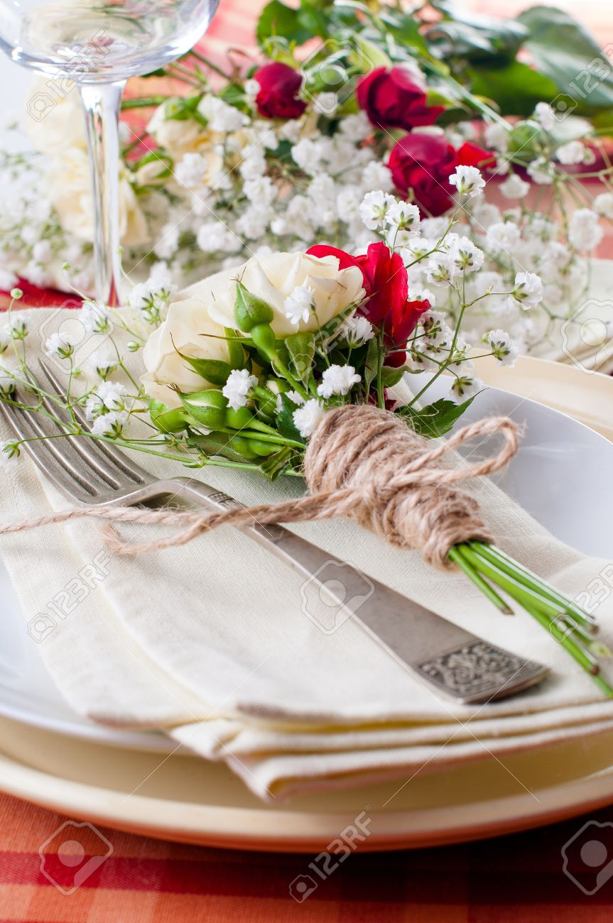 Festive Table Setting With Flowers And Vintage Crockery On The Bright  Checkered Tablecloth In A Country